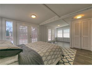 Upstairs bedroom with sitting area - could be utilized as game room.  Entrance to upstairs deck,