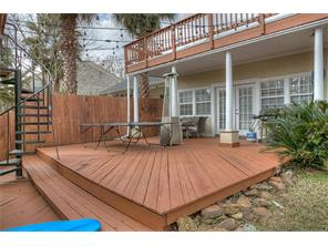 Backyard deck & spiral staircase to deck above boat slip.
