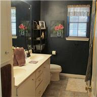 master bath with double sinks and newly updated bathtub surround and separate shower