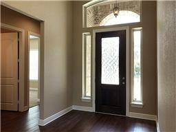 Entry-way features tall ceilings and natural light providing a warm welcome for all your guests!