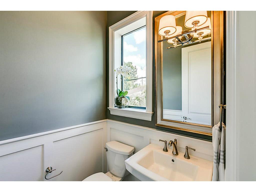 ... Brushed Nickel Fixtures, Custom Framed Mirror, Water Efficient Toilet  w/Soft Close Toilet Seat, Designer Tile, Wainscot Wall, & Tankless Water  Heater.