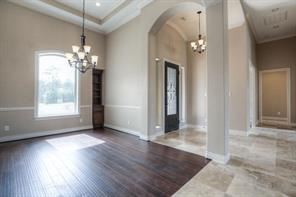 Beautiful travertine flooring and crown moulding throughout, along with high ceilings give the home a light and bright spacious feeling.