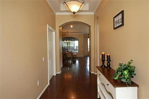 Hallway leading to master suite and Bedroom 2.