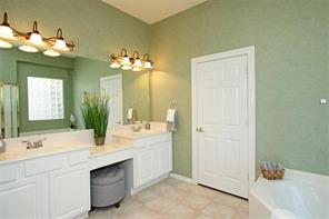 There are double sinks in the master bath as well as a sitting area.