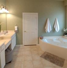 The bathroom is well-lit with natural light.
