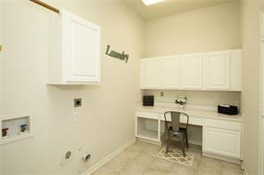 The utility room is spacious with washer and electric dryer hook-ups. The garage is accessed to the left of the picture.