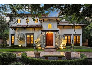 European flair exudes from this gorgeous home resplendent in fine architectural detail.