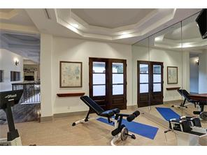 Exercise room opens to large 14 X 6 balcony overlooking pool.  Note layered tray ceiling.