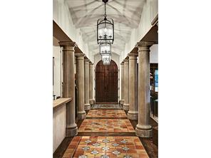 As one enters the front door, the stunning gallery defies all expectations!   It is anchored by Mexican Saltillo tile embellished by striking  hand-painted tiles. Extraordinary architectural collaboration is evident in this home infused w/quality.