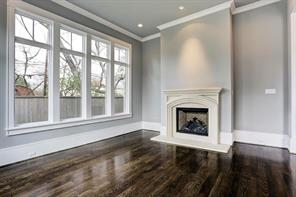 Living room with gorgeous hardwood floors.Image is of another, similarly constructed property.