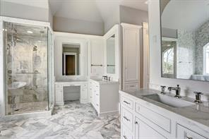 The lavish master bath feels like you are at a spa. Image is of another, similarly constructed property.