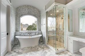 Spa style master bath.Image is of another, similarly constructed property.