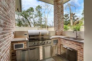 The outdoor summer kitchen allows the chef to entertain outdoors.Image is of another, similarly constructed property.