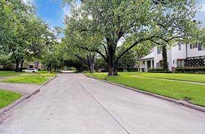 Note the magnificent tree lined street.