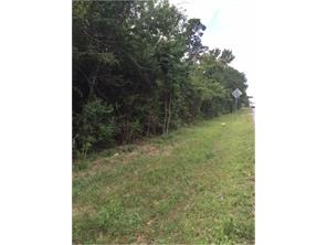 This vacant land is about 3 lots past Rose Rd.The densely wooded lot has approximately 293 feet of road frontage on FM 1097.
