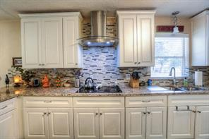 The granite and back splash tastefully complement the other colors throughout the home.