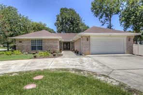 This one story beauty sits on a corner lot with several shade trees.