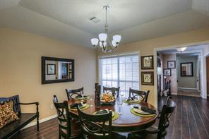The formal dining room is to the right of the entry upon entering the home.