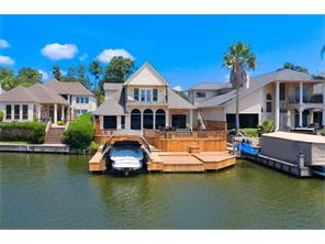 Stunning property directly on the water complete with jet ski lift and covered boat slip.