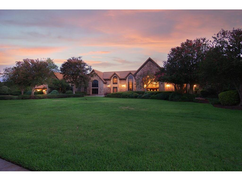 ENDLESS POSSIBILITIES FOR THIS STUNNING HOME!! OVER 12,000 SQ. FT SITS ON 3.9 ACRES. PRIVATE GATED ENTRY - STONE EXTERIOR AND TILE ROOF HAS THE CHARM OF LONG AGO! DRAMATIC DOUBLE STAIRCASE, SOARING CEILINGS, GOURMET ISLAND KITCHEN, WINE CELLAR, GAME ROOM, MEDIA & EXERCISE ROOM!! OVERSIZED MASTER SUITE W/ FIREPLACE & MASTER BATH FEATURES MARBLE, HIS AND HER SINKS, SPA AREA & MORE! BALCONY OVERLOOKING REFRESHING POOL - PERFECT FOR ENTERTAINING! UNRESTRICTED - POTENTIALLY A COMMERCIAL PROPERTY!