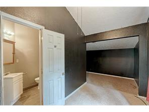 Master retreat features sitting area, plus cozy dedicated sleeping space and full bathroom.  FRESH PAINT COMING SOON!