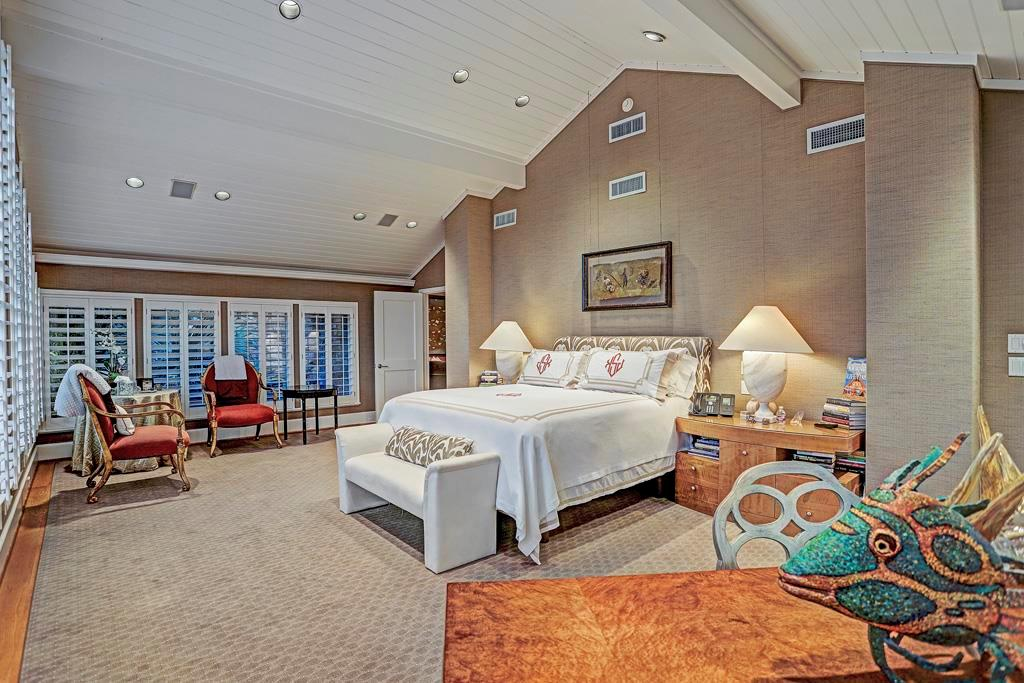 The large multi-room Master Suite spans the distance between the front and rear staircases on the second floor, and includes a separate Sitting Room with white marble fireplace , multiple walk-in closets make-up room,  dressing room and marble bath