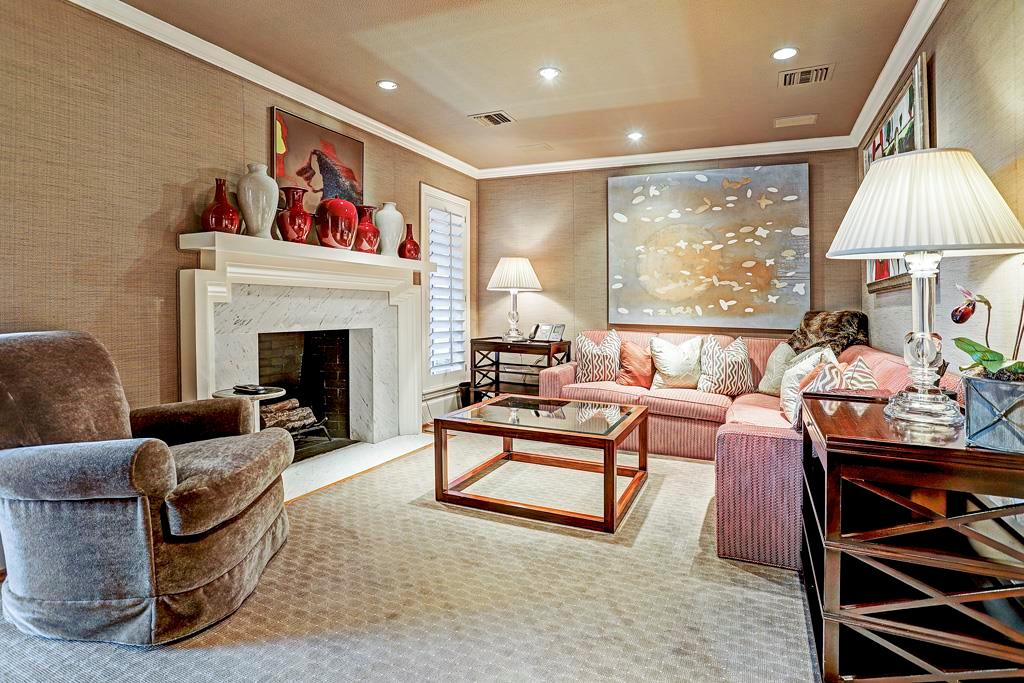 Master Sitting Room - 10  x 9 :  Wood-burning fireplace with white marble surround and custom-carved wood mantelpiece; white marble hearth framed into hardwood floor; custom leather ceiling and recessed art lighting; speakers  with surround sound