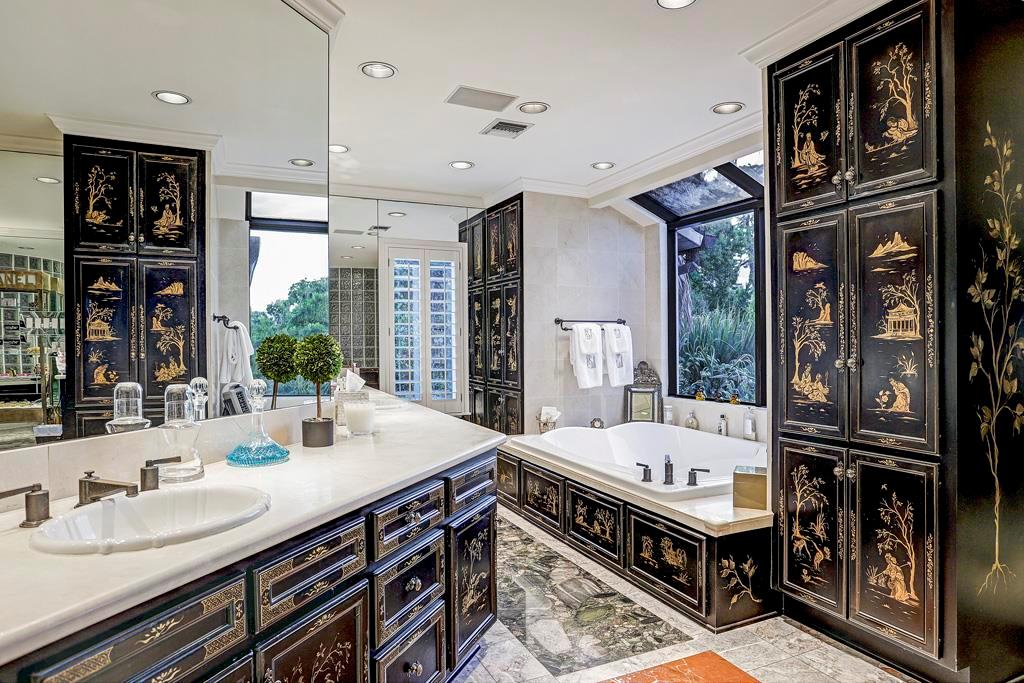 Marble Master Bath: Custom cabinetry with designer hardware and hand-painted chinoiserie accents; Oversized Roma glass-block steam shower with marble seat, Oxygenics Vortex rainfall showerhead with temperature controls, marble walls and glass door