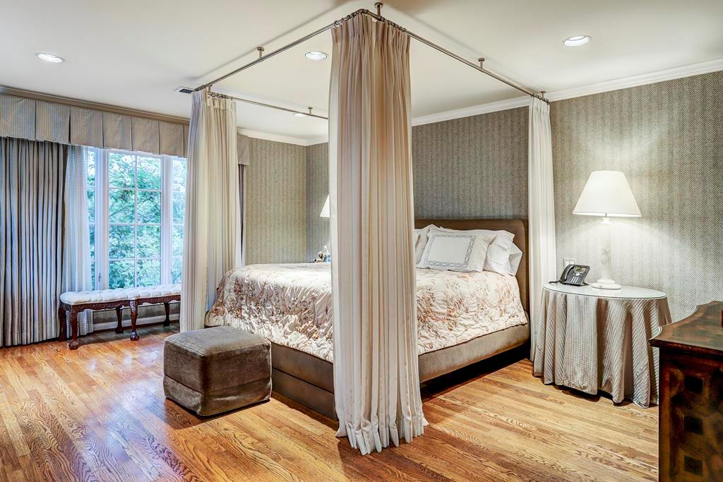 Secondary Bedroom (19  x 16 ) w/Marble Bath: Elegant guest room; could be second master bedroom if desired; ceiling-mounted canopy railing with full length draperies outlining space for queen-sized bed; two walls of tall windows; hardwood floor