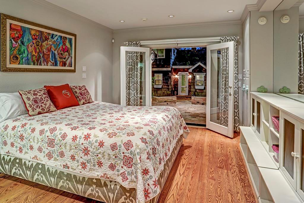 Ground Floor Quarters with Bath / Opt. Bedroom # 5 / Play Room / Exercise Room - Accessed via a separate outdoor entrance independent of the home s interior rooms. Built-ins, mirrored accent wall; hardwood floor walk-in closet & private bath