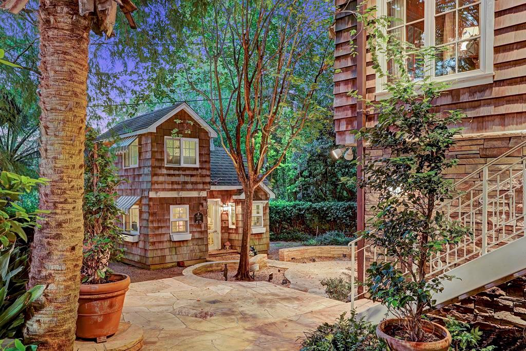 2-Story Child s Play House: Fully finished with dry-walled interiors, recessed lighting, running water and 2 air conditioners;  hardwood floor; hardwood staircase; chandelier, faux fireplace, lighted display cabinet and child-sized kitchen with water
