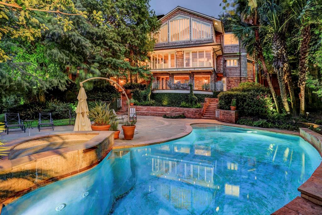 Variable-depth lighted and heated saltwater  pool with flagstone coping and remote controlled features;wide steps and shallow wading area / tanning shelf at end of pool;multiple spillway fountains into pool   Elevated spa; barefoot friendly deck