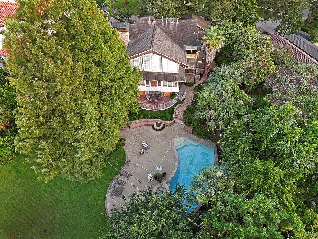 Aerial View of the Rear of the Home on multi-levels; Seller reports tenting the rear yard for catered events in the past with good success;  hosting events with 400 people on the grounds; and  served up to 150 seated / plated persons on the terrace