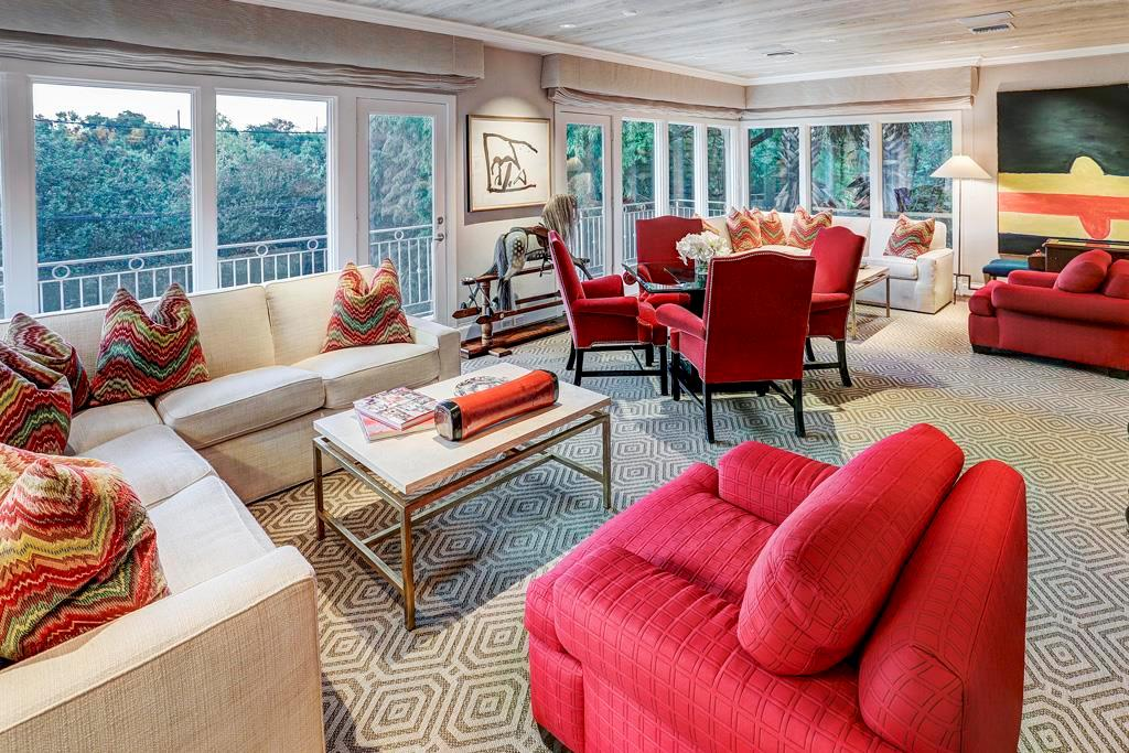 Family Room - 28  x 15 : Seamless glass windows on three walls; dual glass doors open onto covered balcony; custom pickled-planked ceiling and corner Wet Bar with copper sink, mirrored glass shelves and filtered-water ice machine; open to Dining Room