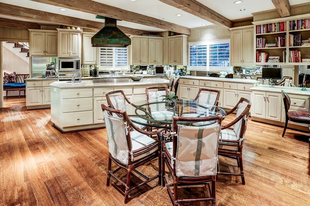 Oversized Granite Kitchen (21  x 16 ) with space for dinette; Dacor and Miele appliances; 2 Built-In SubZero Fridges set side-by-side; 2 Miele dishwashers; chimney-mounted copper range hood with verdigris patina; corner desk; generously sized island