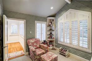 The entrance to the princess suite is via a separate Sitting Room (10  x 9 ) with peaked ceiling, custom walls of hand-tied tulle ribbon, plantation shutters and built-in homework desk with overhead shelves & beverage refrigerator; Stark wood carpet