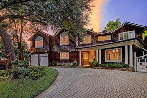 2-story home with cedar-shake shingle siding & Cape Cod styling on oversized bayou-facing lot in River Oaks; front drive with center garden island and paver-stone circular driveway; Off-street parking for multiple vehicles