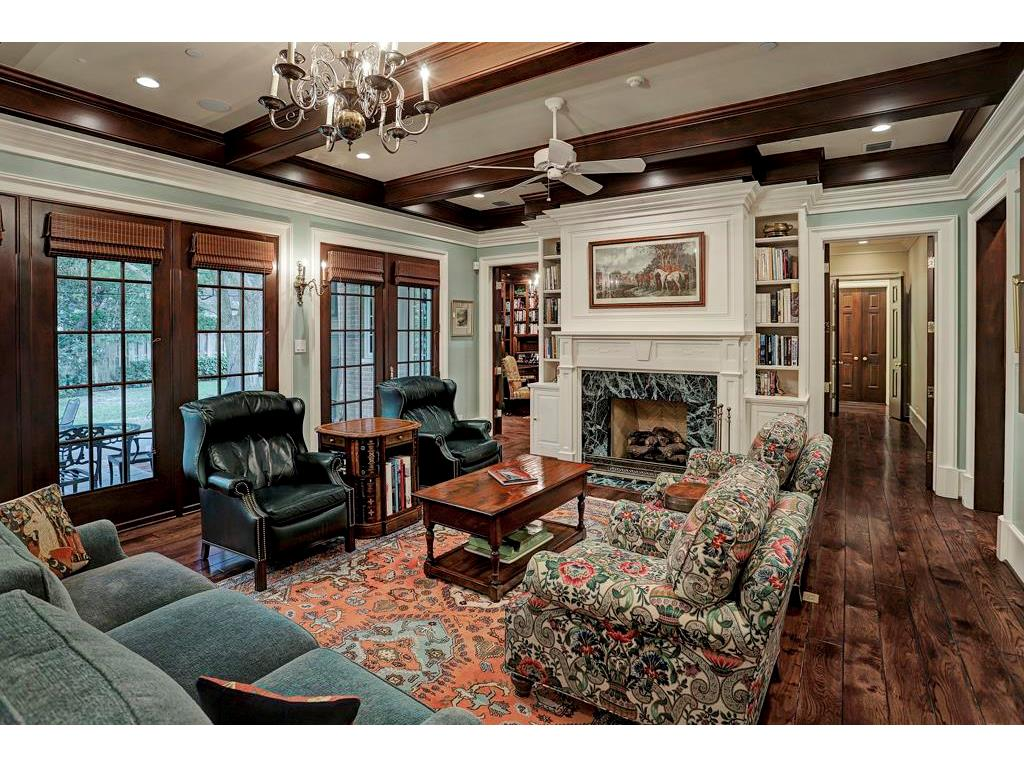 This FAMILY ROOM is an exceptional living and entertaining space with the Wet Bar and Kitchen close by.  The double doors at the end of the hallway to the right lead to the Master Suite, and the Executive Study is through the doors on the left.
