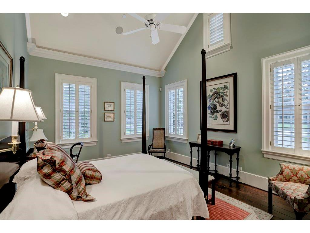 The Second Master Bedroom in the MASTER SUITE has many windows for natural light, a cathedral ceiling, hardwood floors and its own separate Master Bathroom.  This Bedroom has an extra walk-in closet and is steps away from the Exercise Room.