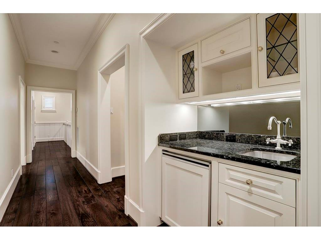 On the 2nd FLOOR in the Hallway leading to a Bedroom & Full Bath on the left, an Extra Room (that can be an Office or another Bedroom) & the 2nd Floor Wet Bar w/a small beverage fridge, granite counter, sink & space for a microwave in upper cabinet.