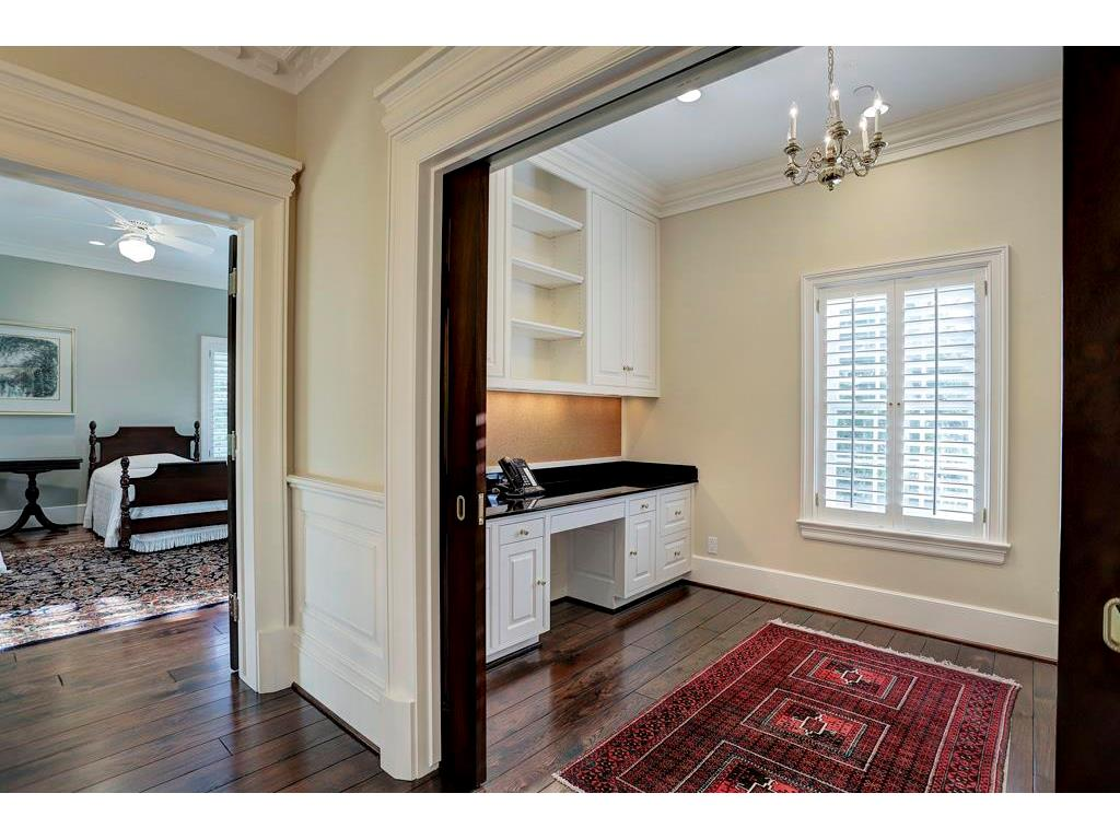 The LIBRARY/READING ROOM on the 2nd Floor has built-in desks with granite tops and upper cabinets with book shelving.  There are double pocket doors for privacy and a large window with wooden shutters.  To the left is another Secondary Bedroom.