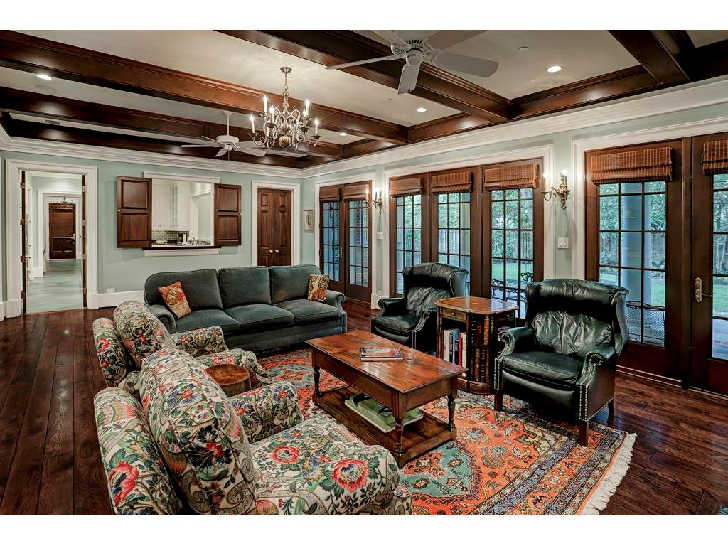 This extraordinary FAMILY ROOM has several divided light windows & two sets of French doors leading outside to the covered Back Porch.  Notice the mahogany beamed ceiling and two ceiling fans.  This spacious room is almost 30 feet long.