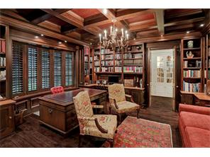 The handsome EXECUTIVE STUDY has extraordinary mahogany built-in cabinets and bookcases, a bay window with mahogany shutters & a mahogany coffered ceiling with decorative inserts.  Notice the recessed lighting & the ornate brass chandelier.