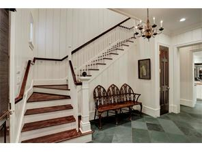 The MUD ROOM has slate floors, shiplap walls, two storage closets, the door leading to the side entry (on the left) and the Back Staircase.  The Kitchen is to the right, and unseen is a conveniently located Half Bathroom.