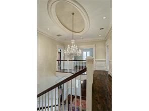 The Ceiling of the 2nd Floor at the top of the exquisite Front Staircase showcases an oval dome and a breathtaking Waterford crystal chandelier with individually stamped crystals.  This treasure will convey with the home.