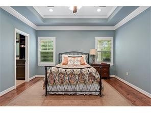 At the end of the day, escape to the master suite and rest peacefully.  Hardwood floors, step up ceilings, recessed lighting and ceiling fan are ready for your furniture.  Views of the back yard too.