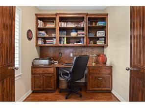 Study with hardwood floors and double stained doors is just off of the living room and entry area.  Built in book case and desk area.  Far enough from the bedrooms to make for a peaceful place for work, study or homework.