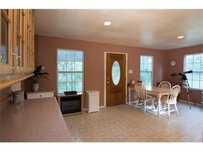 Breakfast area with glass-front cabinetry, granite counters and, best of all, a beautiful view to the woods.