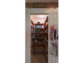 Huge walk in pantry for food storage and organizing your home.