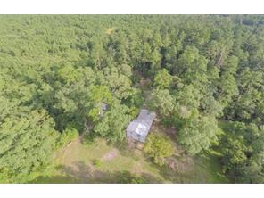 Heavily wooded, secluded property with plenty of privacy.